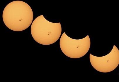 Gambar 4. Sekuens wajah Matahari saat Gerhana Matahari Sebagian 24 Oktober 2014 waktu Indonesia, yang hanya bisa disaksikan dari daratan Amerika bagian utara. Bintik Matahari AR 2192 nampak jelas di tengah-tengah cakram Matahari selama gerhana. Diabadikan dengan teleskop Matahari melalui Observatorium Griffith, Los Angeles (Amerika Serikat). Sumber: Griffith Observatory, 2014.