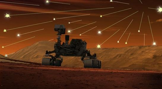Gambar 1. Sebuah ilustrasi dari Robert King yang menggambarkan langit malam Mars di lokasi pendaratan robot Curiosity dipenuhi ribuan meteor perjamnya sebagai imbas dari melintas-dekatnya komet Siding-Spring. Badai meteor tersebut memang sungguh-sungguh terjadi, namun tak ada seorang pun yang berkesempatan menyaksikannya. Sumber: King, 2014.