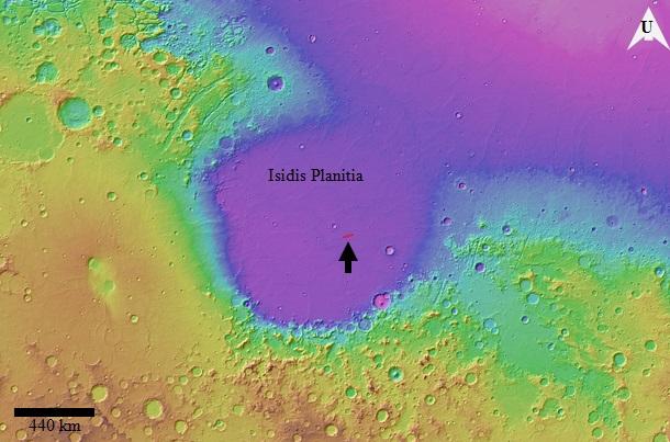 Gambar 3. Dataran Isidis Planitia, tempat dimana Beagle 2 mendarat. Dataran ini adalah sebuah cekungan sedimen dengan permukaan relatif datar yang menjadi pembatas antara tinggian (warna kecoklatan) dengan dataran rendah Mars bagian utara (warna keunguan). Titik pendaratan Beagle 2 terdapat dalam lingkungan ellips merah, ditandai dengan anak panah. Sumber: Grindrod, 2015.