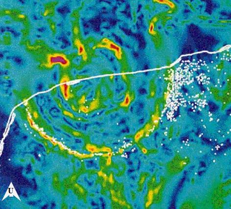 Gambar 3. Kawah raksasa Chicxulub (diameter 170 kilometer) di batas Semenanjung Yucatan dan Teluk Meksiko, berdasarkan peta gradien gravitasi Bouguer. Kawah raksasa ini terbentuk 65 juta tahun silam akibat hantaman asteroid raksasa bergaris tengah 10 kilometer. Terbentuknya kawah raksasa ini menandai bencana ekologis mahadahsyat di Bumi akibat tumbukan benda langit. Bencana tersebut turut melenyapkan populasi dinosaurus. Berdasarkam komposisi mineral piroksen dan olivinnya, ada dugaan bahwa asteroid-tanpa-nama yang menjadi penyebab Peristiwa Chelyabinsk 2013 masih berkerabat dengan asteroid pembentuk kawah raksasa Chicxulub. Sumber: Hildebrand dkk, 1990.